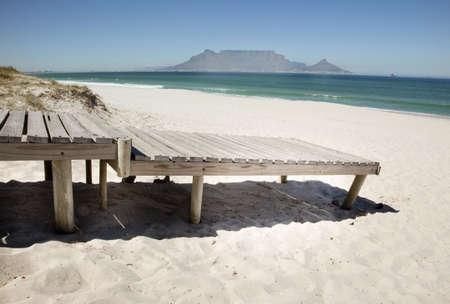 Boardwalk onto beach at Bloubergstrand beach, CApe Town, South Africa. photo