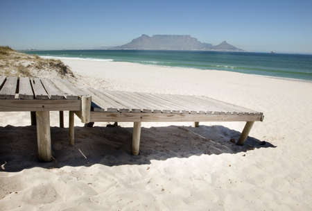 boardwalk: Boardwalk onto beach at Bloubergstrand beach, CApe Town, South Africa. Stock Photo