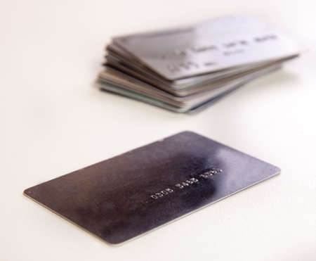 Stack of credit cards on a white background.