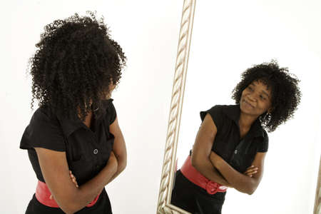 wall mirror: Lady looking at herself in mirror confidently