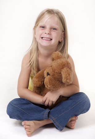 Little girl with a teddy bear smiling funny photo