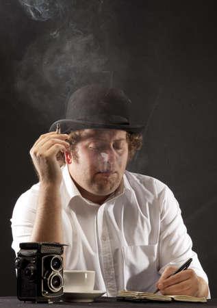 photojournalist: Smoking vintage photojournalist wearing a bowler hat
