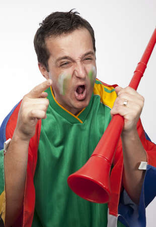 south african: South African supporter with vuvuzela