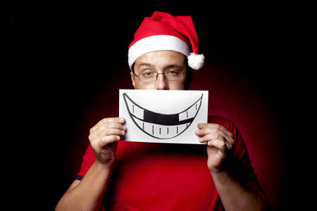 fake smile: Man with fake Xmas smile