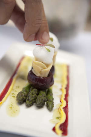 Delicious Baby beetroot on asparagus with goats cheese  Stock Photo