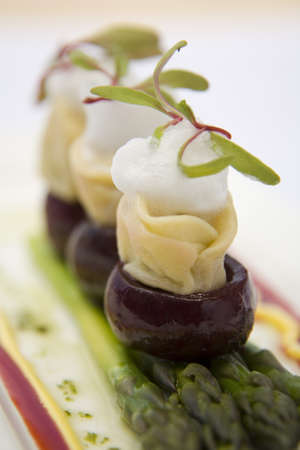 Delicious Baby beetroot on asparagus with goats cheese