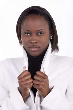 Gorgeous young South African woman in white coat on a white background.