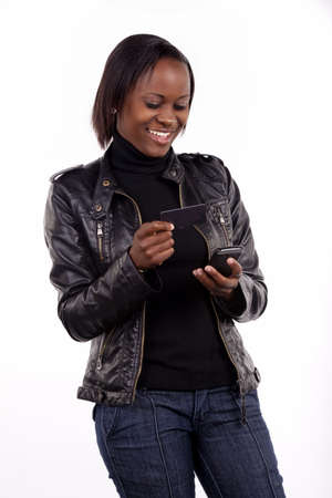 A young woman doing credit card transaction from her phone.  photo