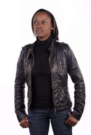 Young South African woman wearing black leather and a serious expression on a white background   photo