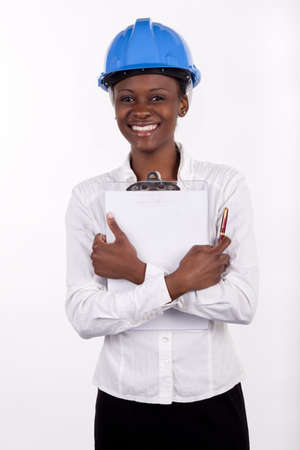 quantity surveyor: Gorgeous South African woman with a notepad and hard-hat