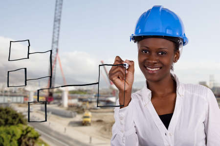 female engineer: Copyspace image of woman with hard-hat making a drawing