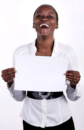 south african: South AFrican woman holding up a blank paper for copyspace.