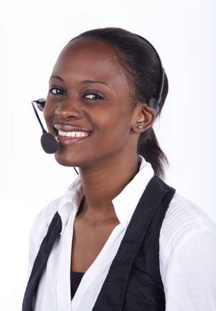 Woman in telephone headset on white background.