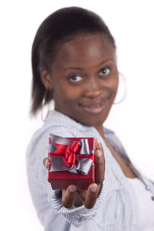 Gorgeous South African woman holding a gift box. photo