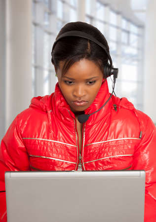 computer centres: Young black South African woman working in a call centre Stock Photo