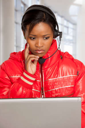 computer centres: Young South African woman with a worried expression
