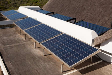 A private installation of photovoltaic panels and solar heating panels at a residential house.