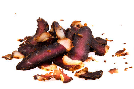 Delicious beef biltong slices, a South African dried meat delicacy. Stock Photo