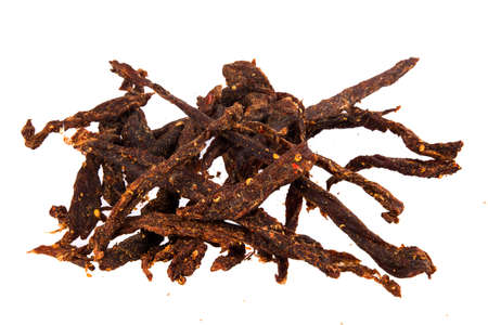 Delicious beef biltong sticks, a South African dried meat delicacy, with chili pepper spices.