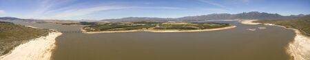 Cape Town, South Africa, January 21, 2019: The main water supply dam to the Cape Peninsula, at very low water levels. This dam was central to the Day Zero crisis in 2018 where Cape Town ran the danger of running out of water. Stock Photo