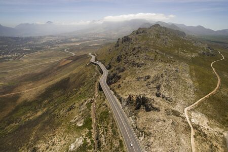 An aerial view over Sir Lowry's Pass, in a North westerly direction towards Cape Town, with the Helderberg mountain range of Stellenbsoch in the background, and Somerset West and Gordon's Bay in the foreground.