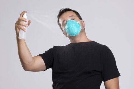 Man disinfecting himself to avoid contamination.