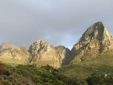 near side: Table Mountian from the side near Llandudno, Cape Town Stock Photo