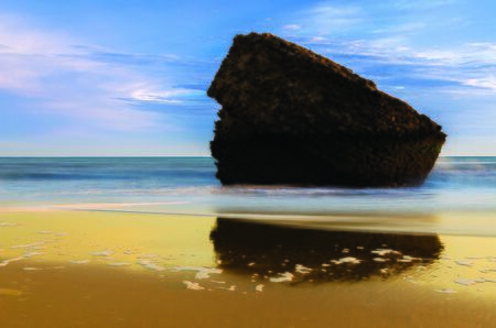 stone inside the sea in the beach