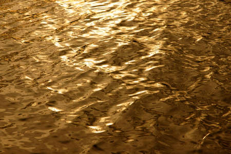 Golden water Background  Stock Photo - 9897764