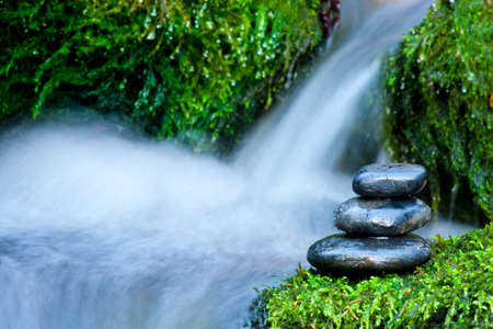 Pebble stones over waterfall  photo