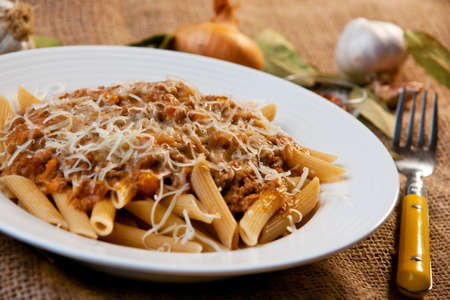 Penne Bolognese with Parmesan Cheese Stock Photo