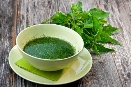 Stringing nettle soup   photo