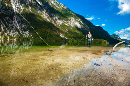 bohinj: Fisherman fly fishing at lake Bohinj, Slovenia