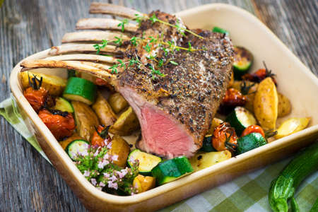 lamb chop: Grilled Rack of Lamb chops with potatoes an vegetables   Stock Photo