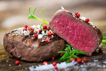Juicy Fillet Steak with Fresh Herbs  Stock Photo