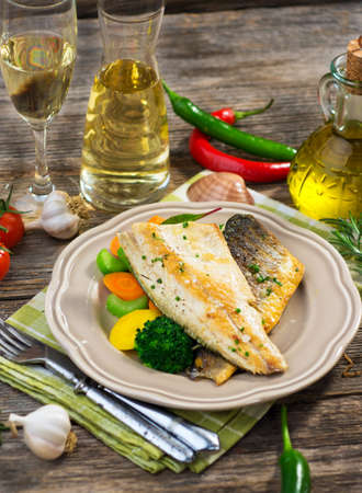 cooked fish: Sea bass fillet with vegetables Stock Photo