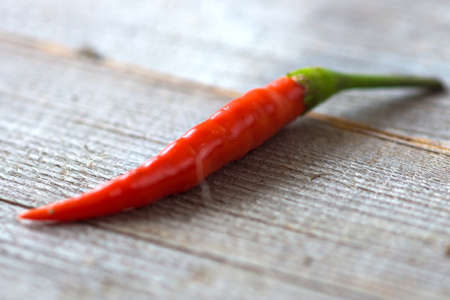 red chilli: Red chilli pepper on wooden Stock Photo