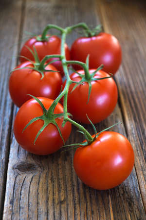 Close-up of fresh tomatoes on wooden background