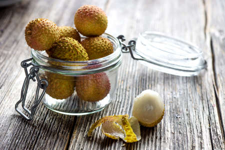 lychee: Lychee on wooden background