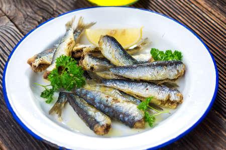 sardines: Sardines with lemon and olive oil Stock Photo