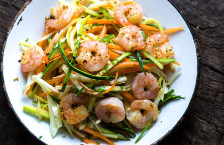 meat and alternatives: Fried shrimps with julienne vegetables Stock Photo