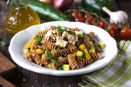 Whole wheat pasta with vegetables and feta