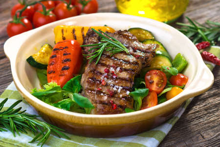 Grilled veal steaks with vegetables