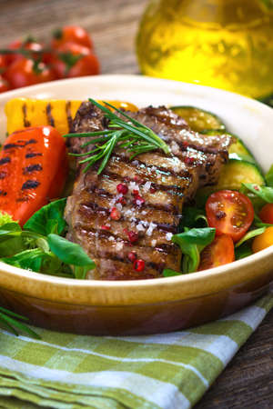 veal: Grilled veal steaks with vegetables