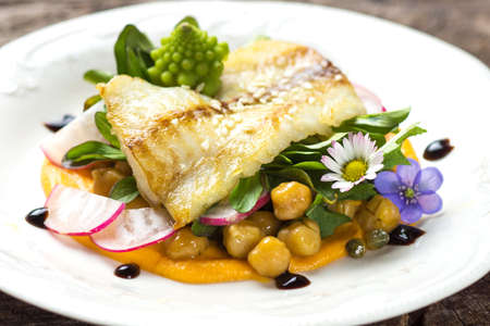 seafish: Fish fillet with chickpeas, carrot puree and vegetables