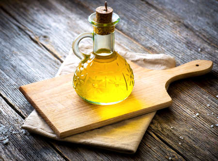 maturation: Olive oil on vintage  wooden table Stock Photo