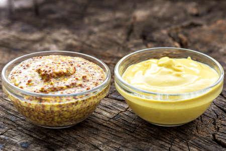 Dijon mustard and mustard on wooden background Stock Photo