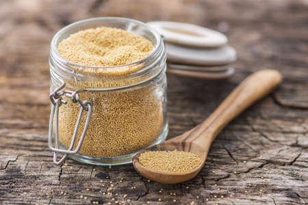 Raw Organic Amaranth Grain on wooden background