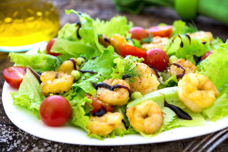 Shrimp salad with cherry tomatoes Stock Photo