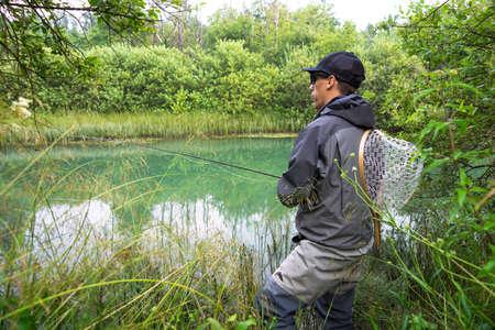 botas altas: Primer plano de la pesca con mosca pescador